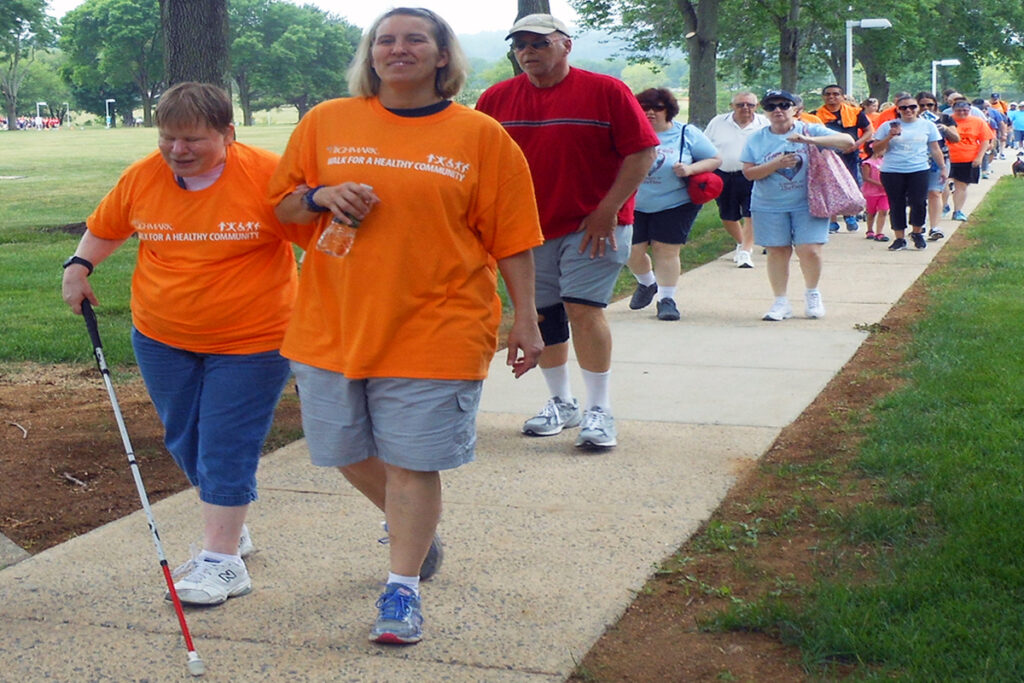 Photo of an agency client and an employee participating in the Highmark Walk for a Healthy Community