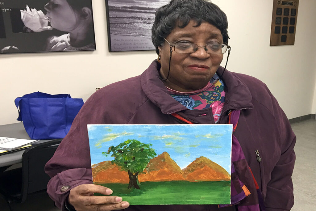 Picture of a client and art that she created