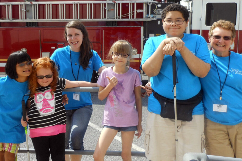 Photo of Camp I CAN! kids and staff as they visit a firehouse
