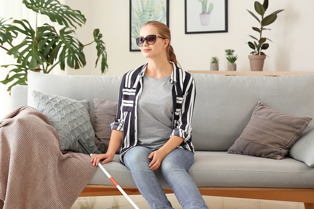 Photo of a woman with a visual impairment in her apartment