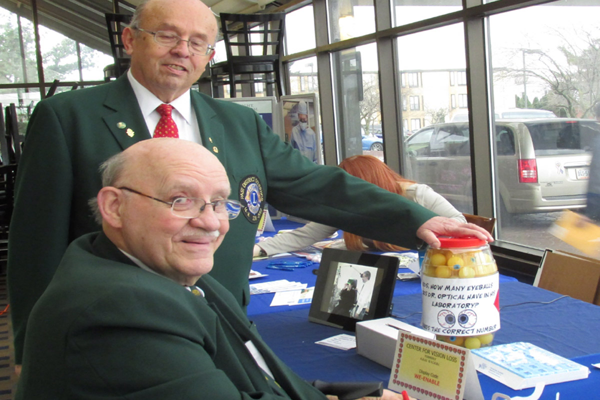 Photo of two Lions Club members in their formal jackets