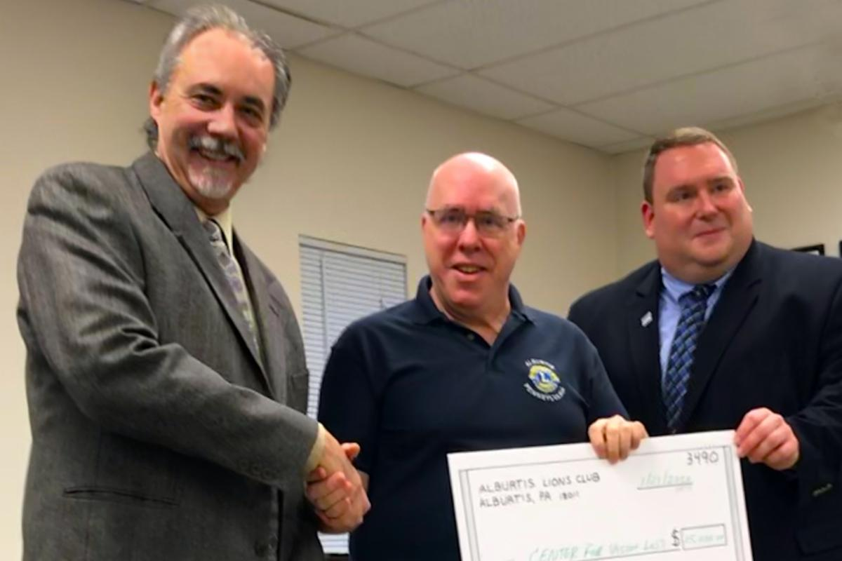 Photo of check presentation from the Alburtis Lions Club