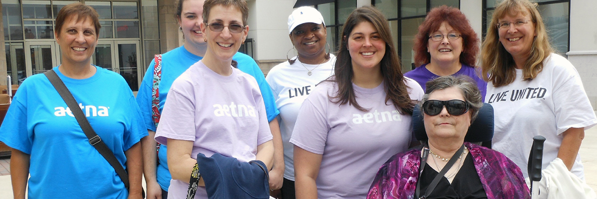 Picture of agency volunteers with a client