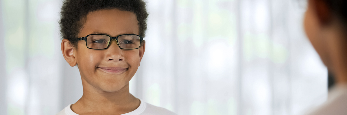 Picture of a happy young man with glasses