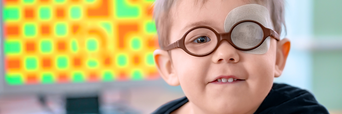 Photo of a child with glasses and an eye patch