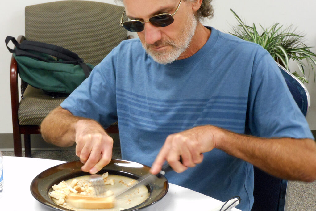 Photo of a male client as he learns how to dine successfully