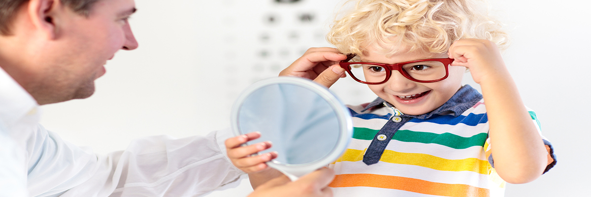 Photo of a preschool-aged boy being fit for glasses