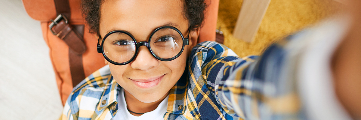 Photo of a little boy with eyeglasses