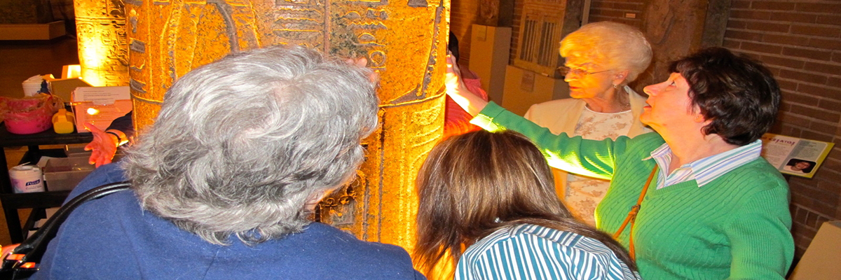 Photo of clients as they participate in a museum touch tour