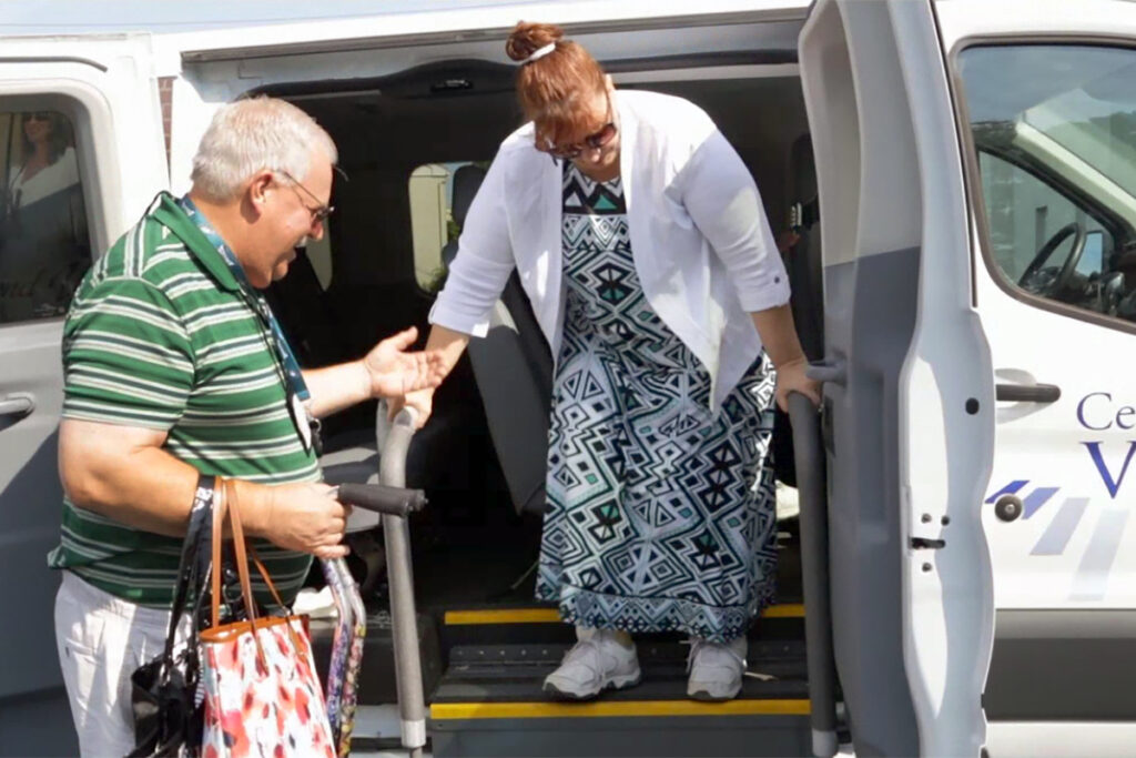 Picture of a client getting out of an agency vehicle
