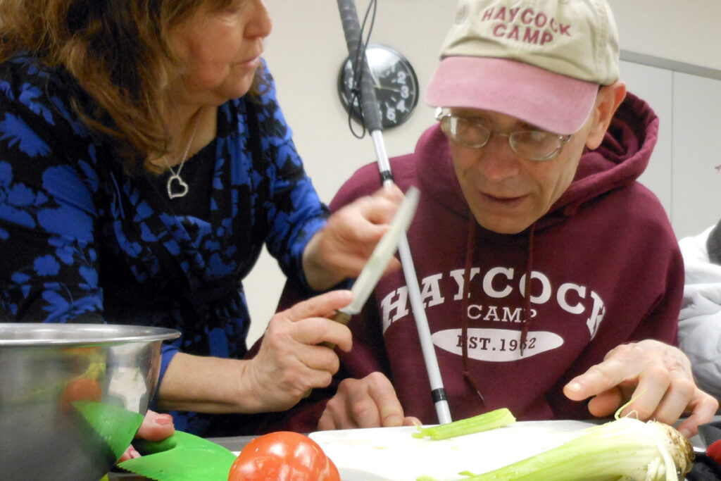 Photo of a client and an instructor in a vision rehabilitation therapy class