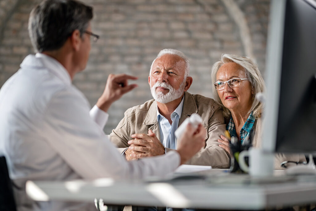 Photo of a senior couple having consultations about their supplement pills with a doctor