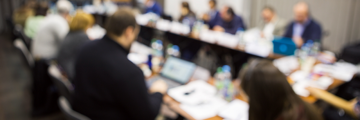 A photo of people in a business meeting in soft focus