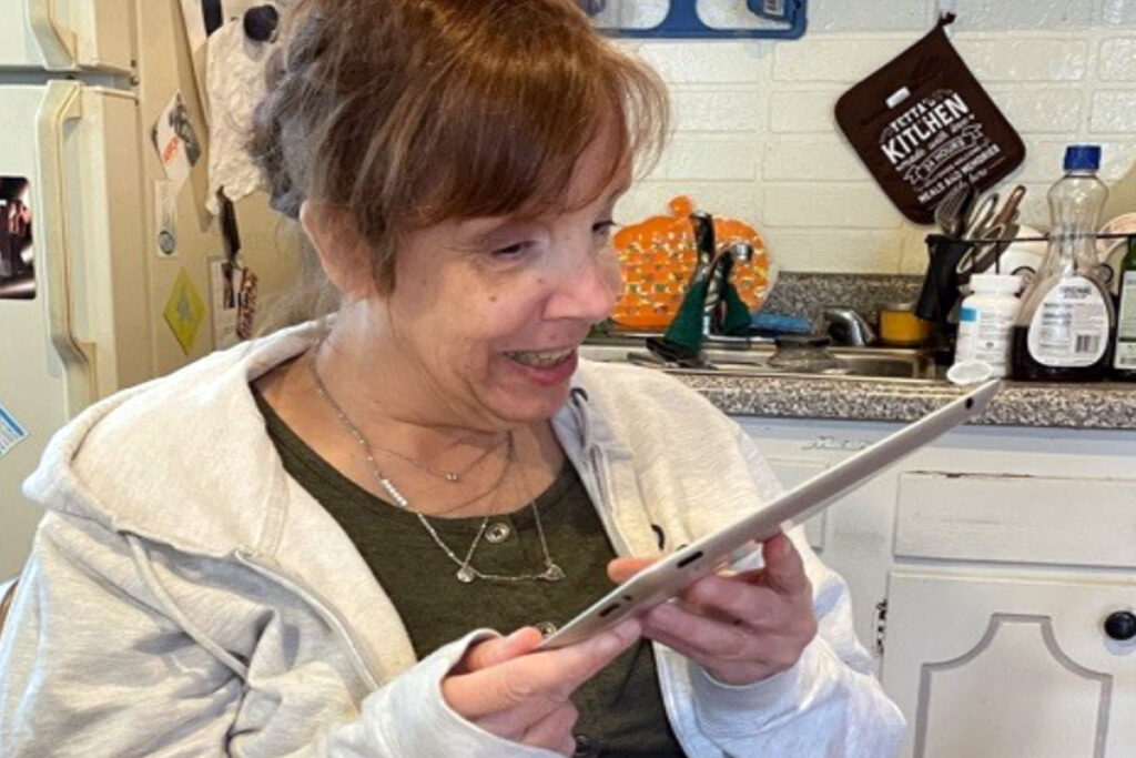 Photo of a woman holding an iPad tablet