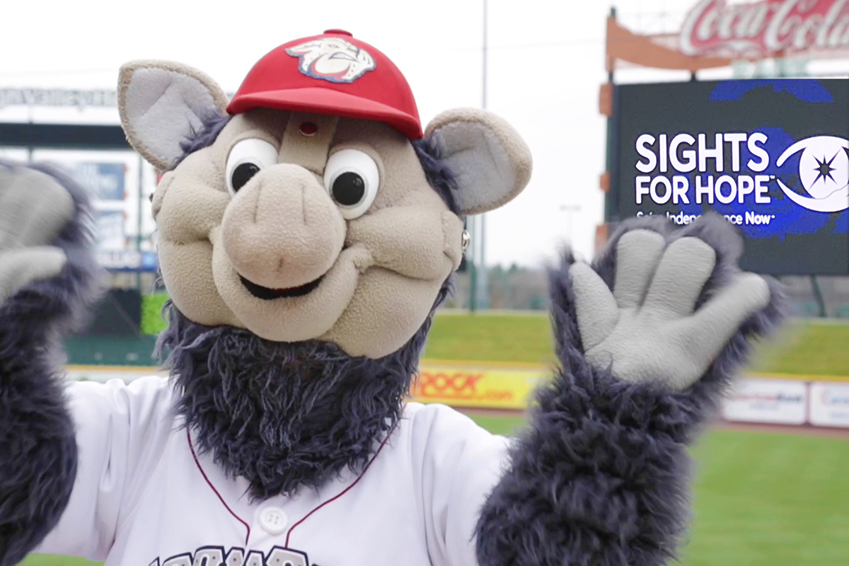Picture of Lehigh Valley IronPigs mascot FeRROUS at Coca-Cola Park with the Sights for Hope logo on the stadium's video board