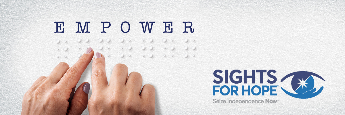 Image of two hands feeling letters in braille that spell out the word EMPOWER