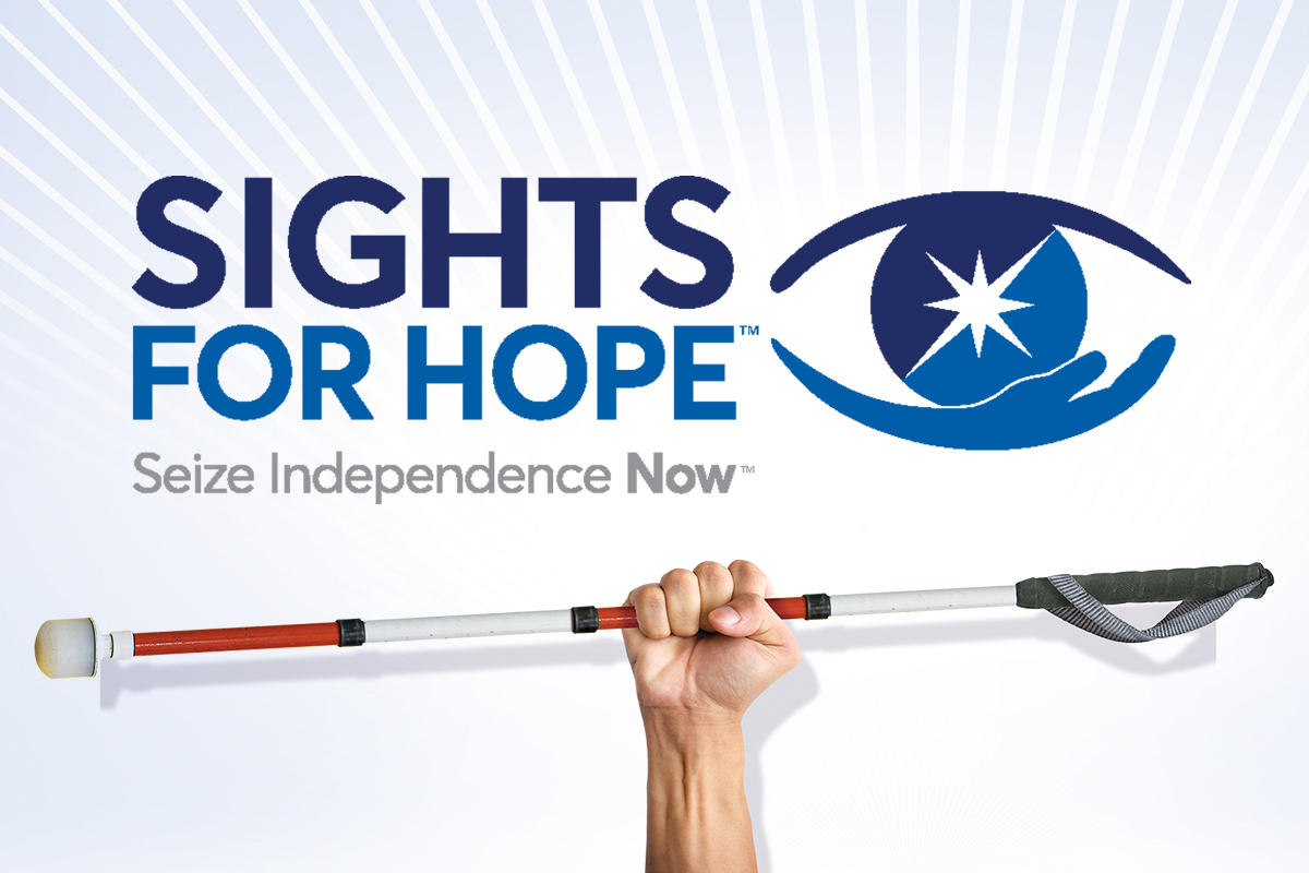 Sights for Hope billboard image of a person's hand holding a white cane with the agency logo above it.